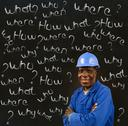 Stock Photo of african american black man worker with chalk questions