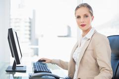 Peaceful blonde businesswoman posing - stock photo