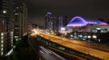 Toronto highway at night with skydome. Timelapse. Footage