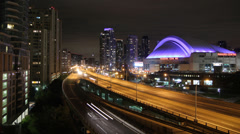 Toronto highway at night with skydome. Timelapse. - stock footage