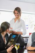 Businesswoman ordering dinner from pretty waitress Stock Photos