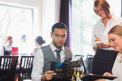Two business people ordering dinner Stock Photos