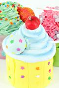 Sweet colorful cupcakes food background Stock Photos
