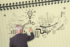 Rear view of businessman touching illustrations on huge notepad - stock illustration