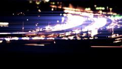 Brilliant blue traffic, freeway, tilt shift light leaks, lens flare, night Stock Footage