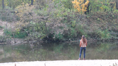 Young woman in beautiful autumn park - stock footage