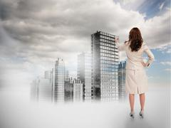 Rear view of businesswoman touching holographic city Stock Illustration