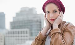 Peaceful casual blonde posing outdoors - stock photo
