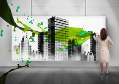 Rear view of businesswoman painting city on screen - stock illustration