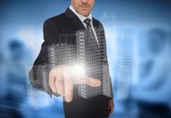 Businessman touching holographic faint city - stock illustration
