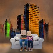 Stock Photo of Couple sitting on couch in front of colored painted city