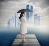 Rear view of businesswoman holding umbrella in front of holographic city Stock Illustration