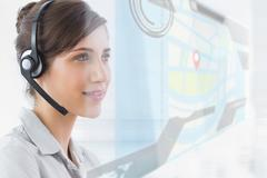 Pleased call center employee using futuristic street map interface Stock Photos