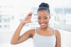 Smiling woman showing asthma inhaler Stock Photos