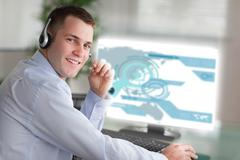 Smiling businessman using futuristic interface hologram - stock photo