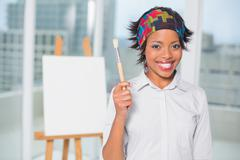 Smiling artist showing her brush - stock photo