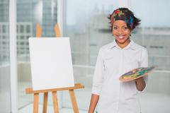 Smiling artist holding palette Stock Photos