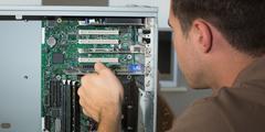 Stock Photo of Computer engineer examining open computer