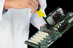 Stock Photo of Extreme close up of computer engineer repairing hardware at night