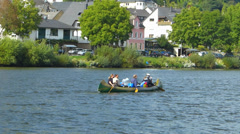 Boat pedalling on Mosel Moselle river valley Rhineland-Palatinate Germany - stock footage
