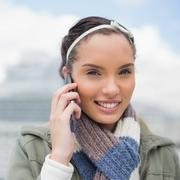 Close up view of attractive woman talking on phone - stock photo