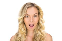 Surprised curly haired blonde posing Stock Photos