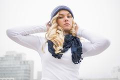 Stock Photo of Serious blonde in winter clothes posing outdoors