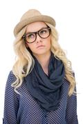 Stock Photo of Serious trendy blonde with classy glasses posing
