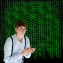 Stock Photo of businessman or teacher with binary on background