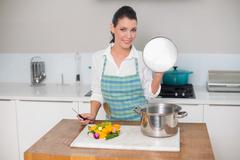 Smiling pretty woman cooking - stock photo