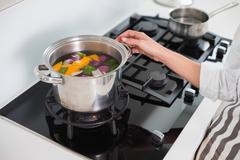 Close up on woman cooking healthy vegetables - stock photo
