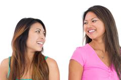 Two pretty asian women posing for the camera - stock photo
