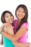 Stock Photo of Two beautiful sisters embracing each other