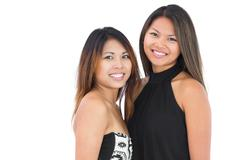 Stock Photo of Two dressed up sisters posing for the camera