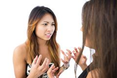 Two cute asian sisters having an argument Stock Photos