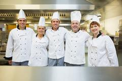 Stock Photo of Five happy chefs smiling at the camera