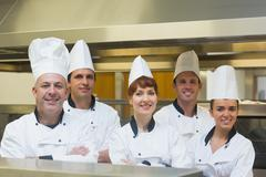 Five chefs posing with crossed arms - stock photo