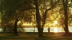 Girl Running At Sunset Time. Stock Footage