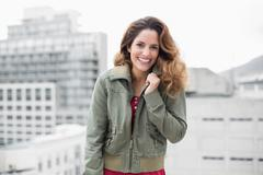 Cheerful gorgeous brunette in winter fashion looking at camera Stock Photos