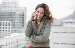 Cheerful gorgeous brunette in winter fashion phoning Stock Photos