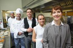 Nice female manager posing with the staff - stock photo