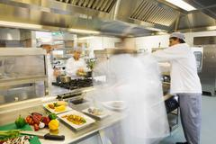 Chefs busy at work Stock Photos