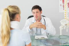 Stock Photo of Concerned doctor having an appointment with a patient