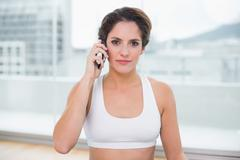 Sporty content brunette phoning Stock Photos
