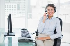 Smiling classy brown haired operator answering a call Stock Photos
