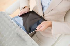 Close up of a businesswoman holding a tablet pc - stock photo