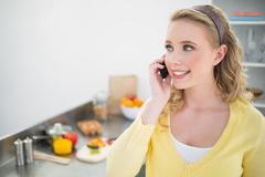 Cheerful cute blonde phoning Stock Photos