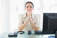 Anxious stylish brunette businesswoman praying Stock Photos