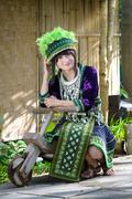 cute asian young girl in beautiful hill tribe (hmong) costume of northern tha - stock photo