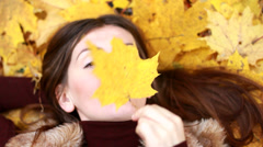 Portrait of girl in the autumn park. Stock Footage